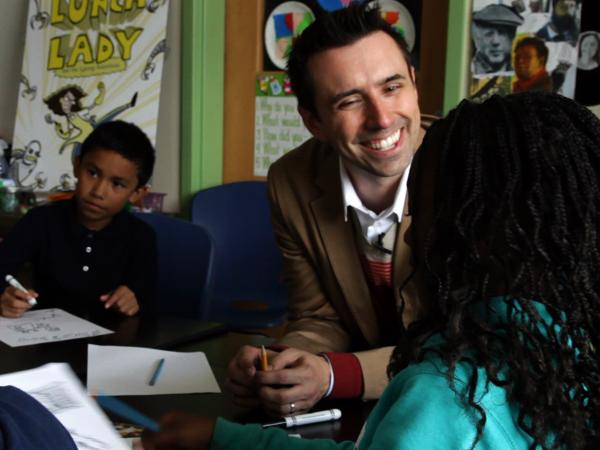 Author Jarrett Krosoczka teaches a drawing class to a group of third- and fifth-graders at the Walker-Jones Education Campus in Washington, D.C.