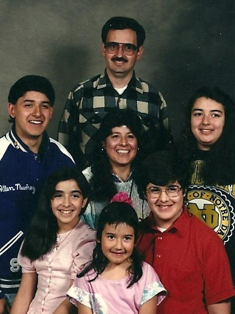 Allen Nunez Wickham (far left) with his family in the early 1990s. His grandmother chose not to teach his father Spanish, and Nunez Wickham also never learned.
