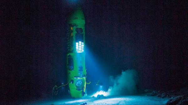 A winch hoists James Cameron's submersible, the Deepsea Challenger, which he helped design.
