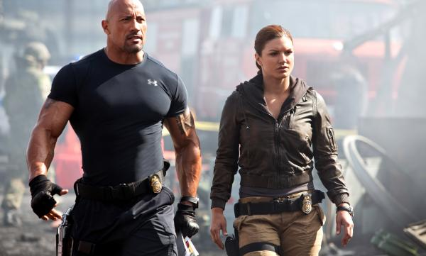 "<strong>Hot Pursuits:</strong> Agents Hobbs and Riley (Dwayne Johnson and Gina Carano) <a href=""javascript:NPR.Player.openPlayer(185532187,%20186355218,%20null,%20NPR.Player.Action.PLAY_NOW,%20NPR.Player.Type.STORY,%20'1')"">enlist Dom and his gear head crew</a> to combat a something something terrorist something skidding explosions muscles<em>.</em>"