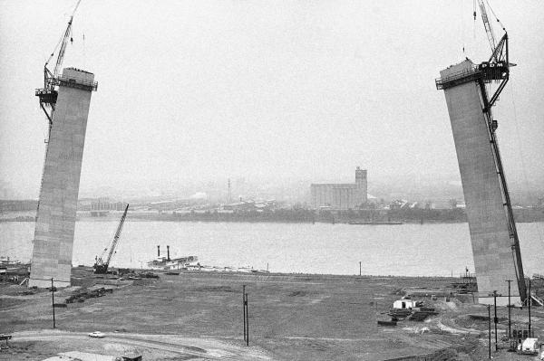 The Gateway Arch in St. Louis' was conceived in the 1940s and completed in the 1960s. It was designed to symbolize the opening of the West. Here, it is shown under construction on June 17, 1964.