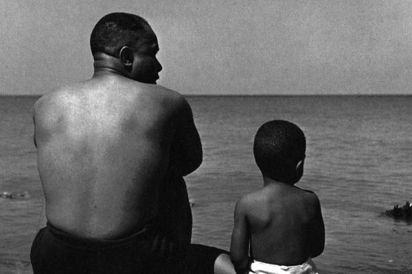 Father and son at Lake Michigan. (1947)