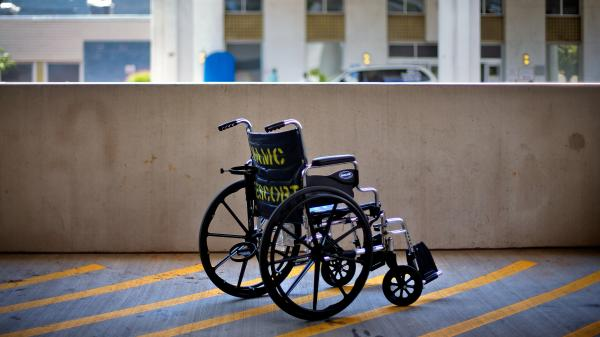 A wheelchair sits outside the Atlanta VA Medical Center in Atlanta. The latest figures show there are about 900,000 claims for benefits pending at the Department of Veterans Affairs.