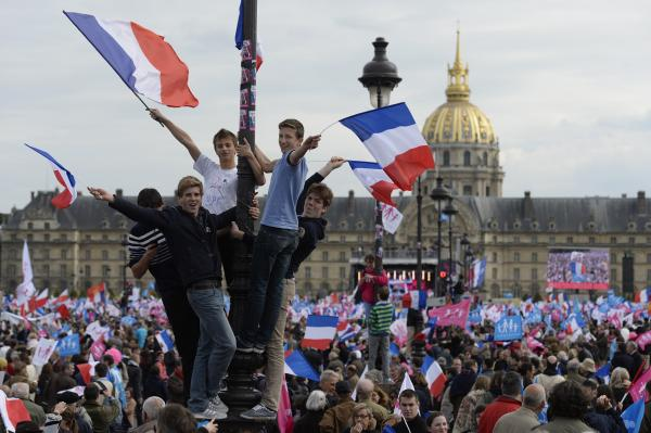 "Thousands of supporters of the anti-gay marriage movement ""La Manif Pour Tous"" (Demonstration for all) wave flags as they gather at the Invalides square in Paris on Sunday."