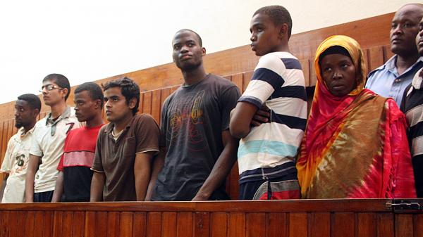 A Nov. 23, 2010, photo shows Michael Adebolajo (center, in dark T-shirt) with suspected Al-Shabab recruits who were arrested by Kenyan police. Adebolajo, one of the main suspects in the brutal murder of a soldier in London, was discharged from the hospital Tuesday.