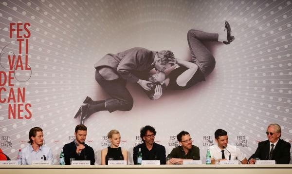 Actors Garrett Hedlund (from left), Justin Timberlake, Carey Mulligan, directors Joel and Ethan Coen, Oscar Isaac and T-Bone Burnett attend the <em>Inside Llewyn Davis</em> press conference at the Cannes Film Festival on May 19.