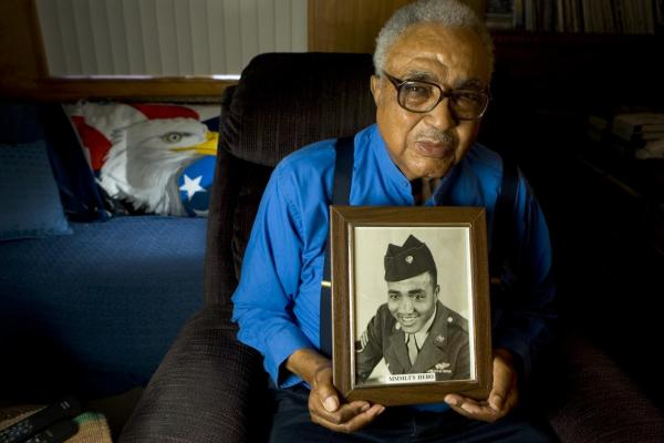 George Porter, one of the original Tuskegee Airmen, at his home in Sacramento, Calif., in 2007. Porter joined the armed forces in 1942 and served as a crew chief, squadron inspector and flight engineer with the Army Air Forces and the Air Force.