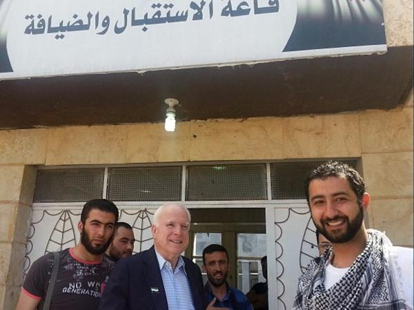 In this photo provided by Mouaz Moustafa and the Syrian Emergency Task Force, Sen. John McCain, accompanied by Moustafa (right) visits rebels in Syria on Monday. McCain, who slipped into the country for a surprise visit, favors providing arms to rebel forces in Syria.