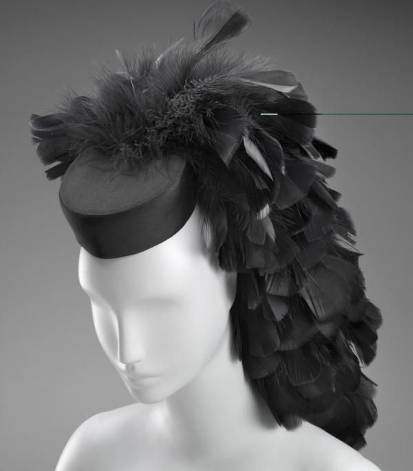 A cocktail hat circa 1963 by Cristobal Balenciaga. Silk, tulle, feathers, plastic, satin weave.
