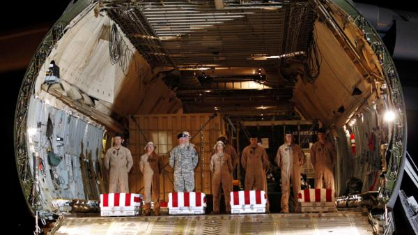 The coffins of Christopher Fishbeck and three other U.S. soldiers killed in Iraq arrive at Dover Air Force Base, Del., on June 8.