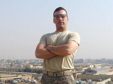 Army Spc. Christopher B. Fishbeck of Buena Park, Calif., poses for a photo on a rooftop during his tour of duty in Iraq.