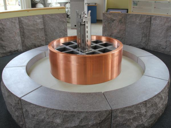 A model of a storage container illustrates how used nuclear fuel will be placed in cast-iron inserts, then encapsulated in large copper cannisters and buried more than 1,500 feet down in the Swedish bedrock.