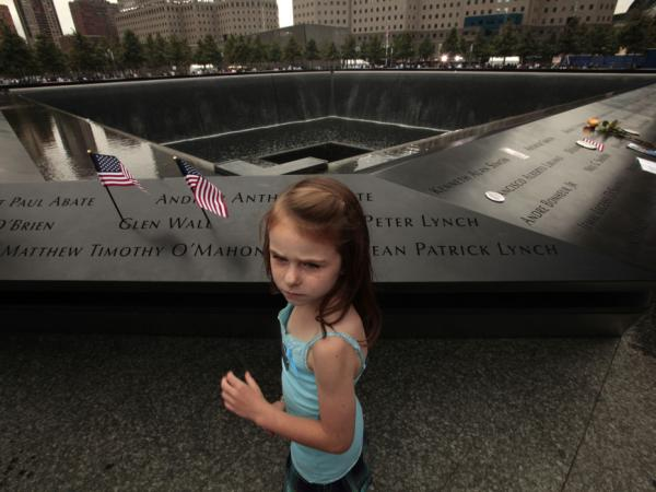 Keri McMorrow, 7, visits the memorial pool where her uncle's name is engraved, during tenth anniversary ceremonies of the September 11, 2001 terrorist attacks at the World Trade Center site.