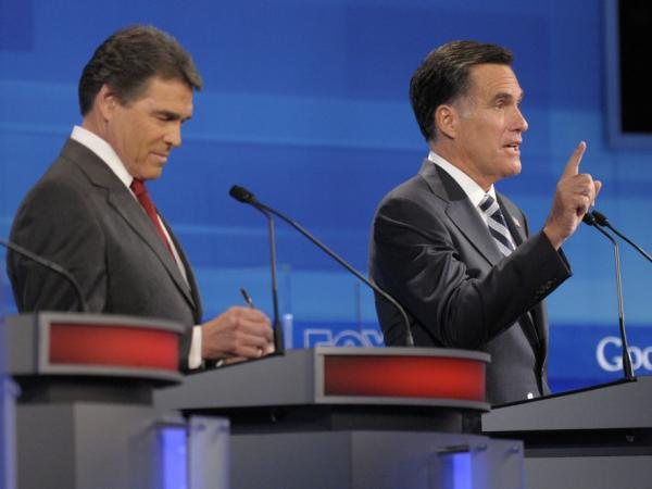 Republican presidential candidate former Massachusetts Gov. Mitt Romney, right, makes a point as Texas Gov. Rick Perry listens, during a debate in Orlando, Fla.
