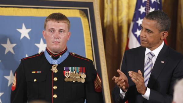 President Barack Obama applauds former Marine Cpl. Dakota Meyer, 23, on Thursday, Sept. 15, 2011, after awarding him the Medal of Honor at the White House.