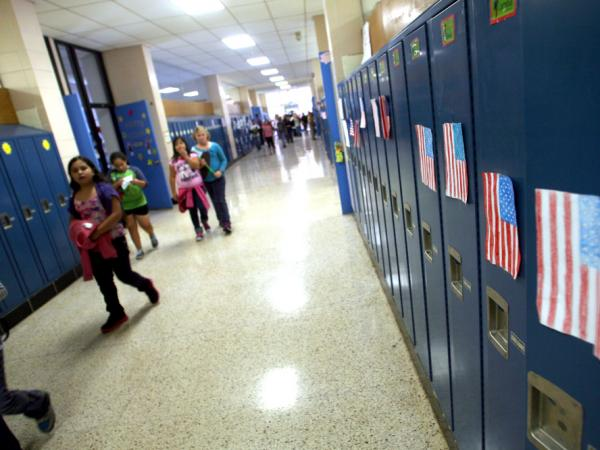 <p>Students walk through the hallways of West Liberty Elementary School. Schools in the town were the first in the state to offer dual-language programs. </p>