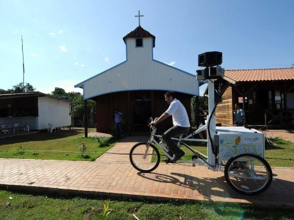 "<p>A Google team member rides a Trike with a 360-degree camera system on it to record the ""Street View for the Amazon"" in Tumbira in August. Google says the images will be ready in a few weeks. </p>"