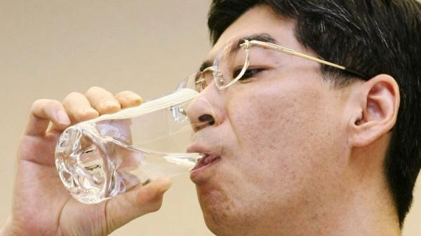 <p>Japan's Parliamentary Secretary for the Cabinet Office Yasuhiro Sonoda drinks a glass of decontaminated water taken from puddles inside the buildings housing reactors 5 and 6 at the Fukushima No. 1 plant.</p>