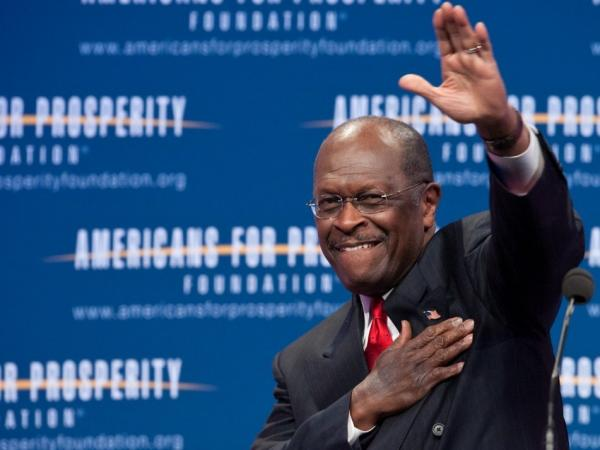 Republican presidential hopeful Herman Cain arrives at a summit for the conservative Americans For Prosperity foundation in Washington on Friday. Days after sexual harassment allegations surfaced, he was greeted here with standing ovations.