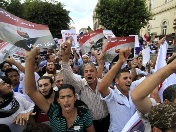 "Demonstrators from a Salafi group chant slogans and hold posters that read, in Arabic, ""Islamic Egypt,"" during a Sept. 23 protest against emergency law in Cairo. Salafi political parties will be among those vying in upcoming elections."
