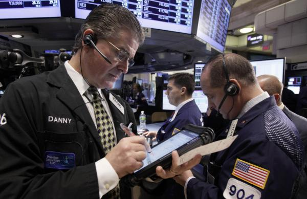 Daniel Kryger, left, works with fellow traders on the floor of the New York Stock Exchange. If the European Union can't agree on a plan, its debt crisis could lead to the kind of financial chaos that economists say surely would hurt the United States.