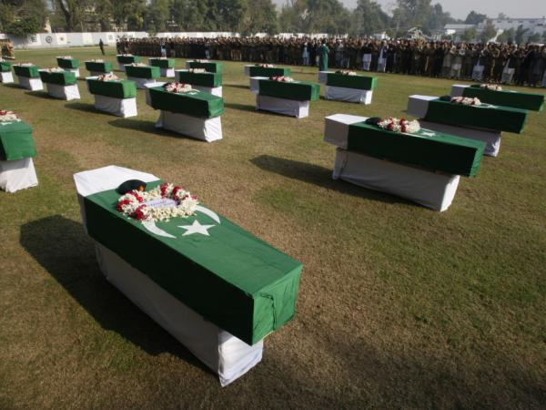 Pakistanis attend a funeral in Peshawar on Nov. 27 for the two dozen Pakistani soldiers killed in a NATO attack a day earlier.