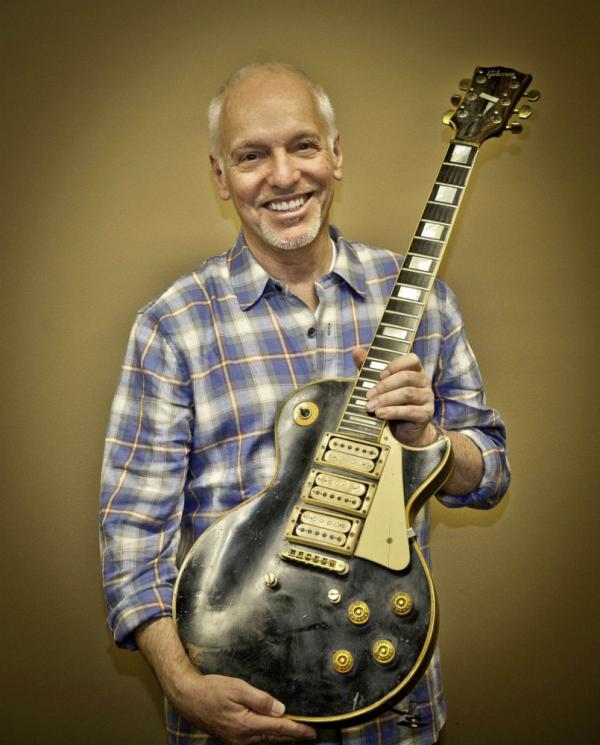 Frampton poses with the guitar he thought he'd lost forever.