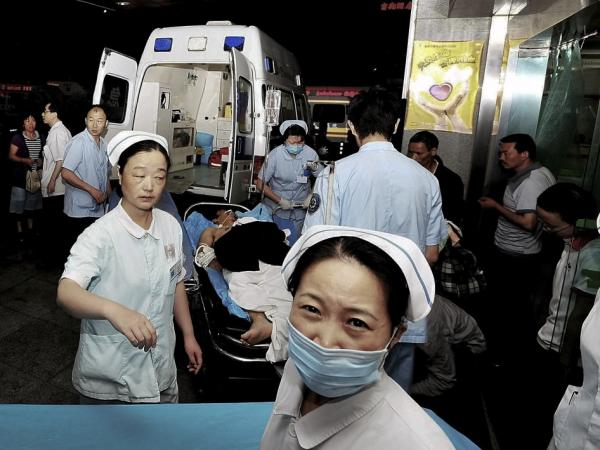 An injured man  arrives at a hospital in Chengdu on a stretcher following an explosion at an electronics factory owned by Foxconn Technology Group, which makes many Apple products. Poor working conditions and low pay at such factories has made many consumers push for Apple to contract work more selectively.