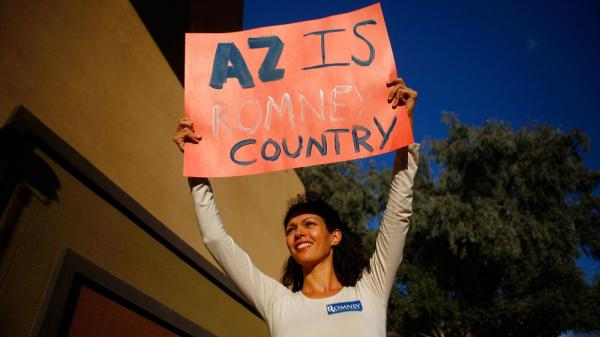 A supporter at a Mitt Romney rally Monday in Mesa, Ariz. The city was founded by Mormons and has a large Mormon population.
