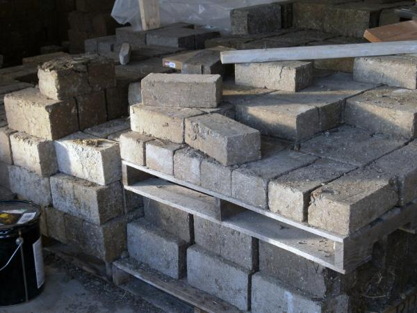 These bricks were made in one of the earth brick presses created by the Open Source Ecology project.