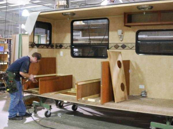 Clinton Lehman, who had been unemployed for nine months before being called back to work, assembles a recreation vehicle at the Jayco factory in Elkhart, Ind., in 2011.