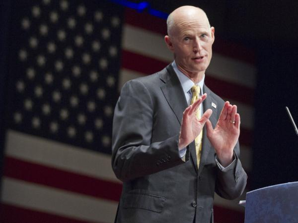 "Florida's Gov. Rick Scott, seen here speaking at the Conservative Political Action Conference in Washington last month, says of Medicaid, ""It is absolutely not sustainable. If we do nothing, this line will bankrupt our state."""