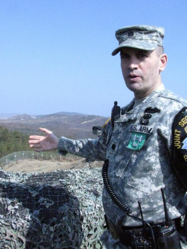 Lt. Col. Ed Taylor speaks as he stands behind a wall of sandbags overlooking North Korea from the South Korean side of the demilitarized zone, or DMZ. Taylor commands a joint American-South Korean battalion along the frontier.