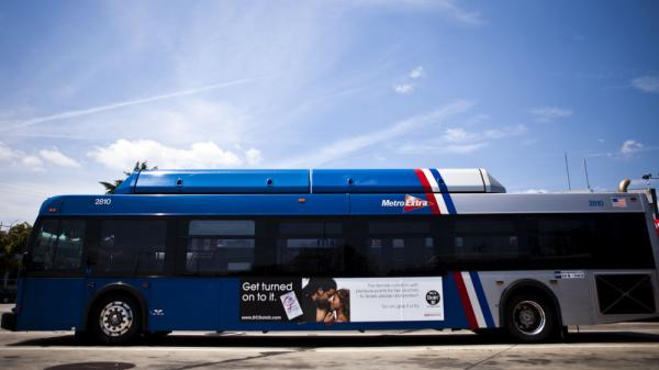 A bus in Washington, D.C., displays an advertisement for a female condom in July 2010. To encourage their use, community groups distributed more than 500,000 of the female condoms, flexible pouches that are wider than a male condom but similar in length, during instruction sessions at beauty salons, barber shops, churches and restaurants.