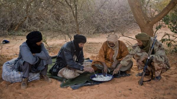 Tuareg rebels eat a meal last month near the Malian city of Timbuktu, which they recently captured. The rebels have taken control of northern Mali, raising concerns about stability in the broader region.
