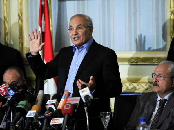 Ahmed Shafiq, who served as prime minister under Hosni Mubarak, will be allowed to take part in Egypt's presidential race. The country's election commission said Thursday that he is eligible, one day after he had been ruled ineligible. In this photo, he's shown speaking at a news conference in February 2011.