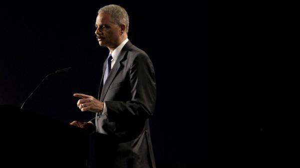 Attorney General Eric Holder, shown speaking at the 2012 National Law Enforcement Training on Child Exploitation earlier this month, tells NPR he's achieved his highest goal: leading a Justice Department that shaped him as a lawyer and as a person.