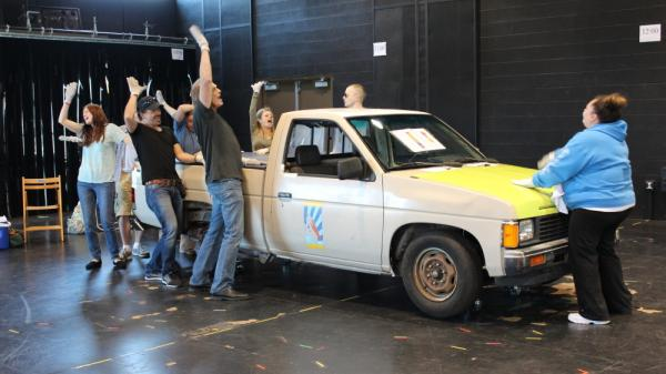 The cast of <em>Hands on a Hardbody </em>keep one hand on the prized truck while in rehearsal for the musical's premiere. It runs from April 27 to June 17.