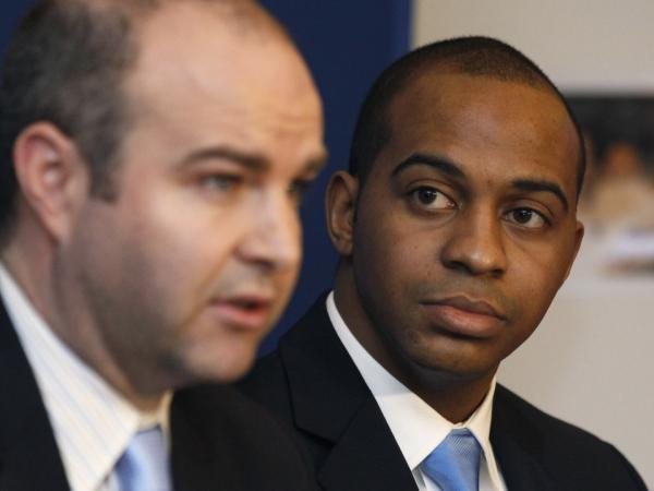 Attorney William T. Gibbs (left), and Tregg Duerson, son of former Chicago Bears player Dave Duerson, announce the filing of a wrongful death lawsuit against the NFL on Feb. 23  in Chicago. The lawsuit accuses the NFL of negligently causing the brain damage that led Duerson to take his own life at 50, by not warning him of the negative effects of concussions.