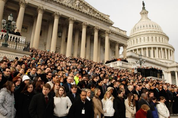 Members of Congress and their staff gather on the steps of the House of Representatives on Jan. 10 for a national moment of silence to honor the shooting victims.
