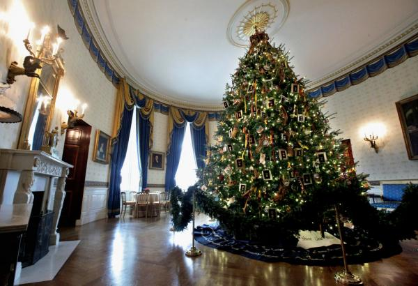 This year, the official tree is an 18 1/2-foot balsam fir in the Blue Room. Decorated with medals and cards made by military children, it honors Blue Star military families.