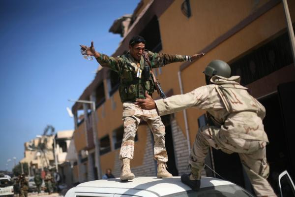 Officials in Libya's transitional government said Moammar Gadhafi was captured and killed Thursday when revolutionary forces overwhelmed Sirte.