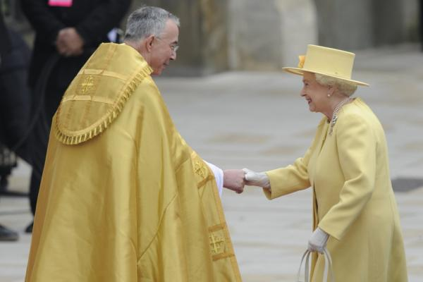 Britain's Queen Elizabeth II shakes hands with the Dean of Westminster Abbey as she arrives.