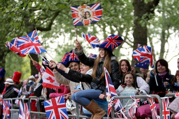 Crowds await the arrival of the royal couple.