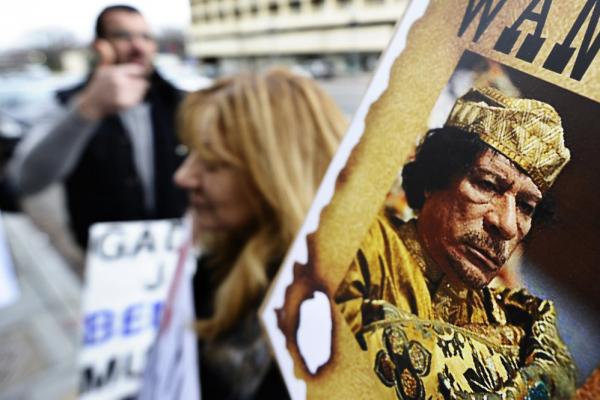 Feb. 24, 2011: Libyan nationals protest Gadhafi's regime in front of a building housing the Libyan embassy in Washington, D.C. Anti-government protests in Libya sparked a bloody crackdown by Gadhafi as opposition forces took control of the country's eastern half.