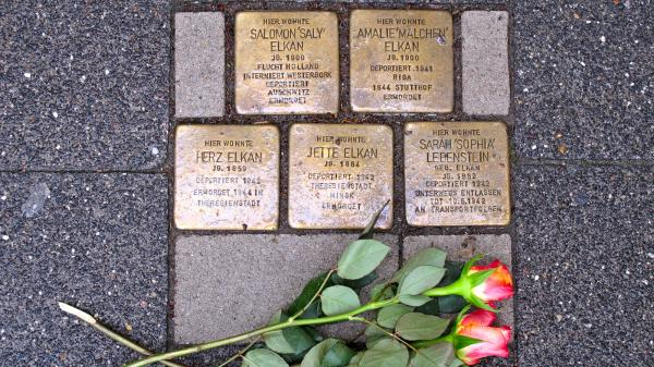 "Brass bricks known as <em>Stolperstein,</em> or ""stumbling stones,"" in front of a home in Raesfeld, Germany, where five members of a single family were forcibly removed by the Nazis. Across Germany, the stones commemorate the millions of victims of the Nazi regime."