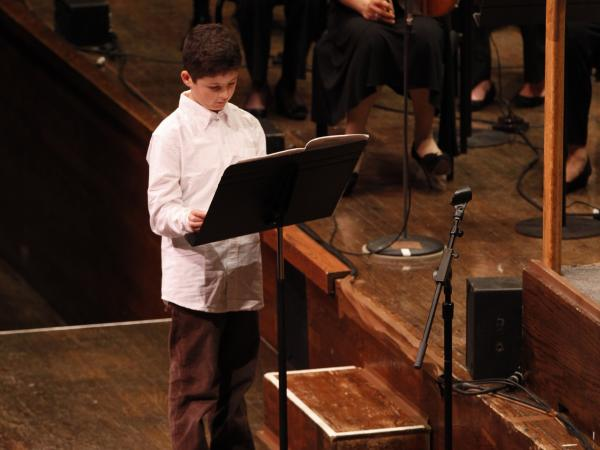 Very Young Composer Milo Poniewozik at the New York Philharmonic's School Day Concerts, where his piece was performed in front of more than 2,000 kids.