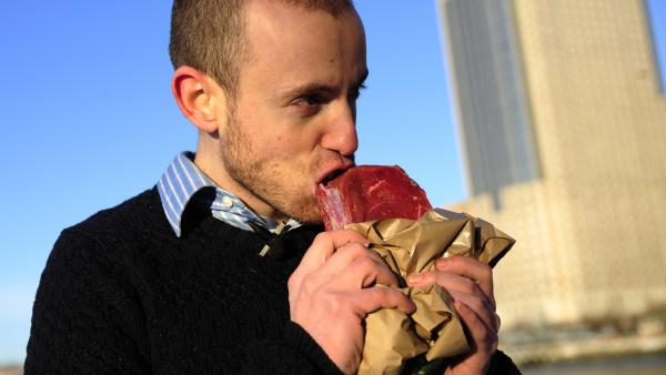 Vlad Averbukh, 29, a follower of the paleo diet, eats raw meat along the Hudson River in New York in 2010. (Averbukh did not weigh in on our blog post on the paleo diet.)