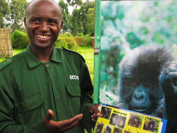 Guide Eugene Twahilga leads treks into Volcanoes National Park in search of gorillas. Before approaching them, he growls quietly to avoid scaring them.