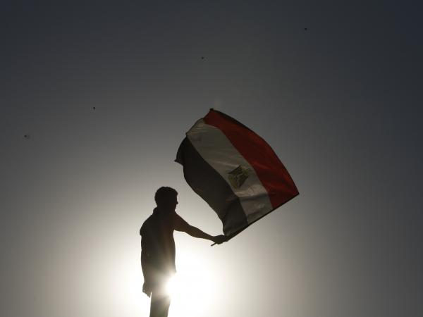 An Egyptian protester waves his national flag in Cairo.